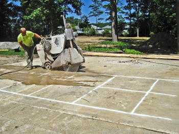 Driveway Concrete Is Cut Into 4 Foot Squares To Save For Use As Patio Tiles  Elsewhere In Yard.